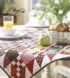 ❤ =^..^= ❤   Quilting Color Trend: Red | AllPeopleQuilt.com |  Scrappy Nine-Patch  A variety of scrappy reds are the perfect combination for nine-patches and triangle-squares in this tabletop quilt.