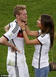 Andre Schurrle is consoled by his girlfriend Montana Yorke after Germany won the World Cup