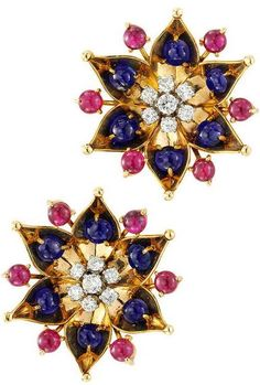 Cartier Ruby Sapphire Diamond Ear Clips. Cartier, A Pair of Ruby, Sapphire and Diamond Ear Clips, each designed as a flower head, set with 6 cabochon sapphires weighing approximately 4.50 carats and 6 cabochon rubies weighing approximately 4.00 carats, the center highlighted by brilliant-cut diamonds weighing approximately 1.00 carat, H-I Color, VS Clarity, mounted in 18K yellow gold, signed Cartier, circa 1940.