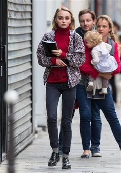 Johnny Depp's daughter Lily-Rose Depp, a budding actress, stepped out in Paris on Sept. 6, 2015, wearing a burgundy turtleneck underneath a leopard-print jacket that she paired with gray skinnies. Tres chic!