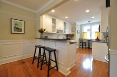 Kitchen open to Dining room with breakfast bar