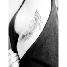 first tattoo, feather, ribcage, feather tattoo.