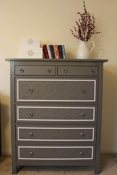Here's a great example of how to use paintable, textured wallpaper to add some personality to an otherwise dull piece of furniture. I love how she outlined the drawers in a contrasting color. And the great thing about paintable wallpaper is that you can make it any color you choose!