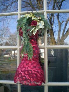 """I went crazy with the dress form this Christmas season!  Here is my front door complete with fresh greens scarf and fresh carnation """"flower pin"""""""