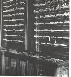 an old black and white image of the rows and rows of maquettes made by Chaumet over the centuries, many of which are topped with pearls 1920s Jewelry, Royal Jewelry, Gems Jewelry, Antique Jewelry, Jewlery, Glass Display Case, Chaumet, Queen, Tiaras And Crowns