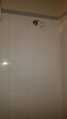 Shower tiles, dirty grout