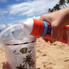 One way to sneak booze onto the beach: Sunscreen Tube Flask