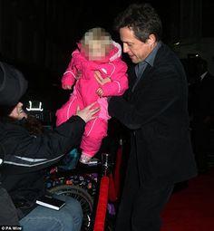 Hugh Grant with stranger baby  http://britsunited.blogspot.com/2013/02/hugh-grant-shows-off-his-paternal-side.html