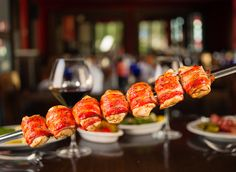 Texas de Brazil is the premiere Brazilian steakhouse known for its 16 various cuts of meats. Bacon-Wrapped Chicken Bites is one of their popular dishes. Barbecue Pork Ribs, Bbq, Bacon Wrapped Chicken Bites, Brazilian Steakhouse, Dinner For Two, Chicken Wraps, Smoked Bacon, My Favorite Food, Texas De Brazil