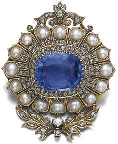 Sapphire, half-pearl and diamond pendant/brooch, late 19th century. Of floral and foliate design, claw-set with a cushion-shaped sapphire weighing 14.76 carats, surrounded with half-pearls, rose diamonds and a cushion-shaped diamond. #antique #pendant #brooch