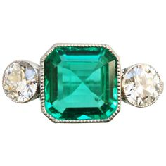 Art Déco Emerald Diamond Platinum Ring | From a unique collection of vintage three-stone rings at https://www.1stdibs.com/jewelry/rings/three-stone-rings/