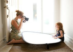 duh! what a great idea >>> Use a car windshield shade to take pictures in a dark house.....