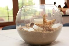 Caitlins beach theme bridal shower centerpieces...can use my terrarium bowls