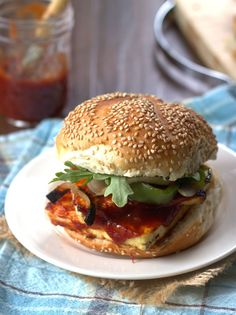 Simmer up some savory maple whiskey barbecue sauce and slather it on some grilled tofu for these intensely delicious barbecue tofu sandwiches.