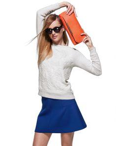 cobalt skirt, cream sweater, orange bag   J.Crew