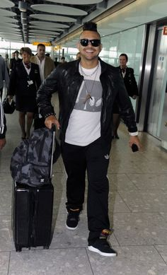 Sean Paul is seen arriving at Heathrow Airport sporting a mohawk. Sean Paul, Heathrow Airport, Bomber Jacket, Celebs, Funny, Jackets, Fashion, Celebrities, Down Jackets