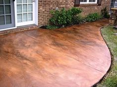 Acid-stained Concrete Patio -- Looks like copper! Click the instructions for a brief how-to video on doing this technique.