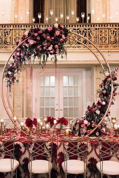 Tall wedding centerpieces on a long wedding table a metal ring adorned with burgundy and white roses Tall Wedding Centerpieces, Flower Centerpieces, Wedding Decorations, Stage Decorations, Centerpiece Ideas, Floral Wedding, Wedding Colors, Wedding Flowers, Wedding Dresses