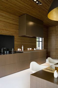 Modern kitchen, slatted pine tongue and groove ceilings and walls.