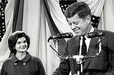 November 9, 1960: A beaming Jackie Kennedy and a happy JFK, during his acceptance speech  at the Hyannis Armory in Massachusetts following the long election night.