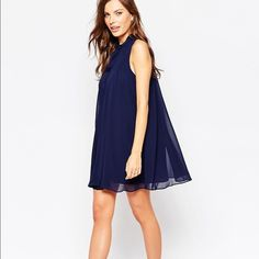 BCBG pleated mini dress Very classy blue BCBGENERATION pleated mini dress with high neck. Layered Chiffon high neckline Tie Closure fully lined regular fit. Machine washable and true to size. Worn once for 1 hour. In new condition BCBGeneration Dresses Mini