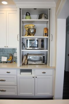 hidden microwave and toaster oven. would love to have the built in towel roll holder too