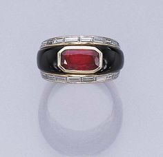 A RUBY, ONYX AND DIAMOND RING, BY MARINA B.   Bezel-set with a cut-cornered rectangular-cut ruby with onyx shoulders and baguette-cut diamond trim to the ribbed hoop, size 6½, with French assay mark  Signed Marina B.
