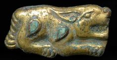 "Gilt Bronze Zoomorphic Buckle Inlaid with Turquoise - OS.239  Origin: Central Asia  Circa: 600 BC to 400 BC  Dimensions: 1.45"" (3.7cm) high x 2.75"" (7.0cm) wide  Collection: Near Eastern Art  Style: Scythian  Medium: Bronze, Turquoise"