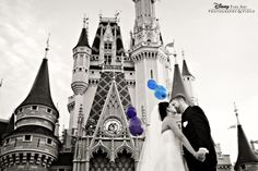 Bridal portrait session at Magic Kingdom in front of Cinderella Castle, complete with Mickey Mouse balloons