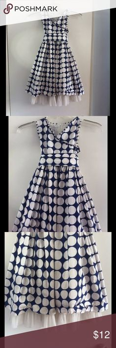 🎀Girls Navy Dress White Polka Dots Pippa & Julie Absolutely adorable and in great condition! Maybe worn twice! Freshly laundered but could use a pressing. Navy blue with white polka dress with ruffle trim. Zip up back. Features an attached cotton lining with tulle trim at hem. Matching self tie sash/bow. Girls size 8. By Pippa & Julie. Pippa & Julie Dresses Casual