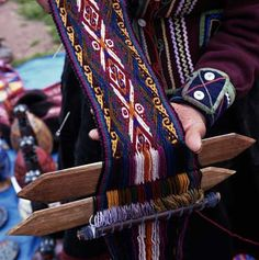 Chincheros Belt Weaving >< At Peru's Chincheros market, a weaver displays a traditional Indian belt, still in progress. From shearing, spinning, and dying the wool, to weaving the brightly patterned cloths, Chincheros textiles are created entirely by hand.  Photo Credit: Andrea Pistolesi/Getty Images