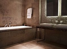 Bathroom suite featuring Argento natural stone floor and wall tiles by Lapicida.com.