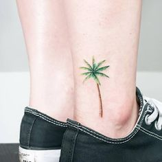 Palm tree tattoo on the ankle.