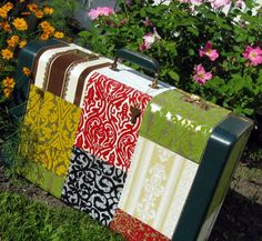 Cover a suitcase with wall paper. This is for you @Dusti Dusti