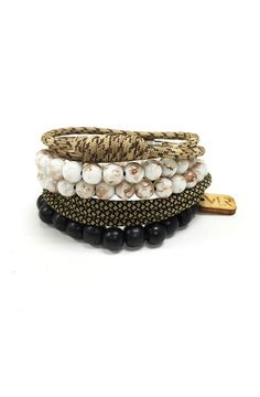 This pack of bracelets features one double wrap long knot bracelet, one wood beaded stretch bracelet, one glass beaded stretch wrap bracelet, and one triple wra