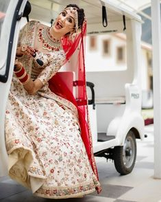 Red for that pop of color over floral embroidered ivory dupatta !! #red #bridallehenga #white #latest #modern #indianbride #2018 #designer #shaadisaga