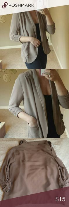 """Dressy or Casual Taupe Cardigan Beautiful, open cardigan by Bobeau. Bought from Nordstrom. Pleated detail at sleeves and shoulders. Side pockets. Can be dressy with all black and statement necklace but can dress it down with distressed jeans, boots and white tank. Taupe color. 3/4 sleeves measure 19"""", shoulder to shoulder is 16"""" and length is 27"""". bobeau Tops"""