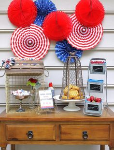 Pin for Later: 99 Ways to Make This Your Best Fourth of July Ever! Party On! A Red, White, and Blue Backdrop Simple party accessories (and found props, like the wire baskets shown on the table here) are artfully arranged for a down-home vibe.