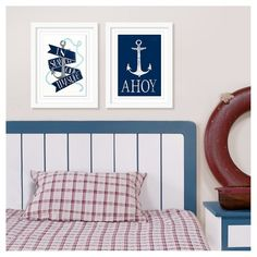"Deep-sea days and nautical nights await when you hang this Ahoy Framed Art from Pillowfort in your boy's or girl's bedroom. The kids' wall art is a rectangular framed piece in crisp white and navy blue. An anchor fills the top two-thirds of the print while the word ""Ahoy"" in all caps dominates the bottom. Drop anchor and come aboard with this friendly, sea-faring art."