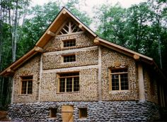 just an amazingly beautiful cordwood house with stone foundation.
