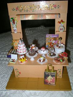 Casa de muñecas en miniatura de bolsas de compras de lujo joyas pastel dulces de leche de huevos de Pascua