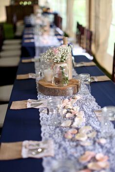 Rustic wedding reception decor - Lace runners and navy blue linens dressed up the banquet tables {Jasmine Rose Photography}