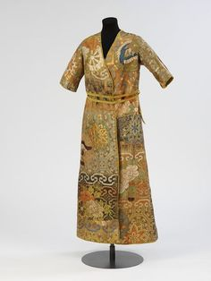 Evening coat    Place of origin:  London, England (made)    Date:  1913 (made)    Artist/Maker:  Anne Talbot