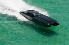The boat is made from carbon fiber and uses numerous auto-inspired touches, such as sleek body lines, authentic tail-lights and Corvette badges. Chevrolet Corvette, Corvette Zr1, 2012 Corvette, Fast Boats, Speed Boats, Black Corvette, Offshore Boats, Naval, Boat Stuff