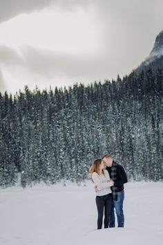 Check out the blog to see more of this fun couples session while on vacation in Lake Louise in the winter including a snow fight! Fun, snowy winter Lake Louise vacation photos. Making memories in the mountains with  a couples photo shoot at Lake Louise. Book a photo shoot on your next vacation. Best activities to do in Lake Louise that aren't in all the travel blogs. What to do in Lake Louise. Best vacation souvenirs. Fun things to do in the Rocky Mountains.