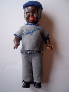 """13"""" composition """"Jackie Robinson doll"""", wearing a wool-knit """" Brooklyn Dodgers """" uniform, United States, 1950, by Allied Grand Mfg. Co."""