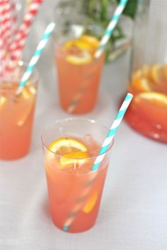 The Best Party Punch . made with frozen concentrated lemonade & orange juice, cranberry juice, lemon-lime soda, sugar & fresh slices of lemons & oranges. Drink Me, Food And Drink, Alcoholic Punch, Non Alcoholic Drinks, Party Drinks, Fun Drinks, Beverages, Cranberry Juice, Orange Juice