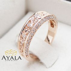 Show off your commitment to that special someone with this 14K rose gold diamond wedding band from Ayala Jewelry. Custom handmade and forged to perfection, using only the highest quality rose gold, it features a band with filigree accents tucked in between glistening diamonds. The effect is a perfect balance of style and design. It is a unique half eternity diamond engagement ring when worn and will give your look that finishing touch you crave. This is a limited edition Ayala Jewelry…