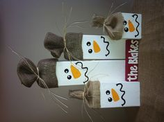 Snowman family made from discarded wood.