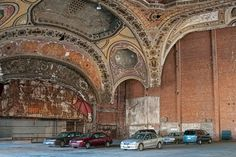 (Bob Jagendorf/Flickr) World's Coolest Car Parks: Michigan Building, USA (A former theatre and office building in downtown Detroit, the Michigan Building dates back to 1925. It closed as a theatre in 1976 and became a nightclub. When this closed too, the office tenants threatened to leave unless there was adequate parking, so the building owners converted the beautiful theatre into a car park and kept its ornate plaster ceiling, grand lobby and balcony foyers intact. The theatre also happens…